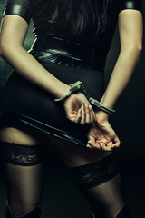 Woman in handcuffs