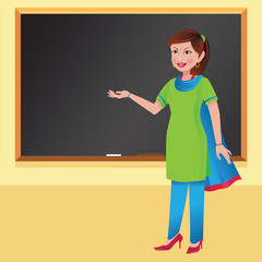 Indian woman teacher in front of a blackboard