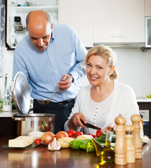 Ordatary mature couple cooking healthy food