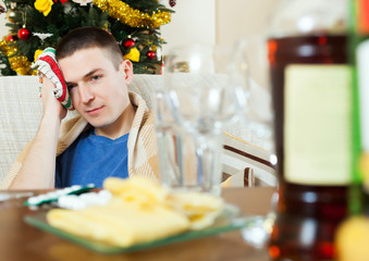 Man having hangover after   New year party