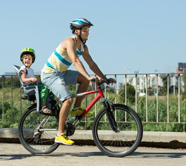 Father with child on bicycle
