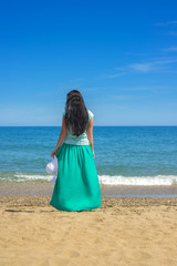 Brunette with long hair on the beach