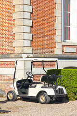 Golf cart near club