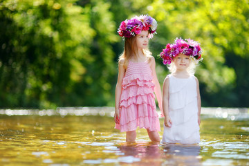 Two little sisters wearing flowers crowns
