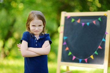 Adorable girl being unhappy about going to school
