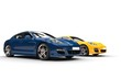 Modern fast cars - blue and yellow, side angle view