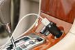 Leinwandbild Motiv USB charger plug with charging cable on a car