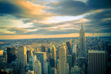 New York City skyline under dramatic evening sky
