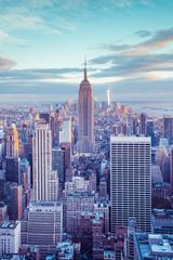 New York City skyline under pastel evening sky