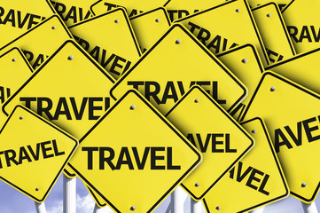 Travel written on multiple road sign