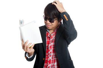 Asian man don't understand reading  book