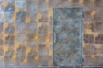 rusty wall background with metal door