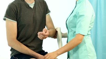 Man having arm securing on physiotherapy session movie