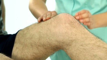 Physiotherapist examining patient knee video