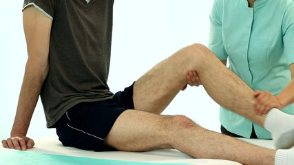 Chiropractor making leg rehabilitation film