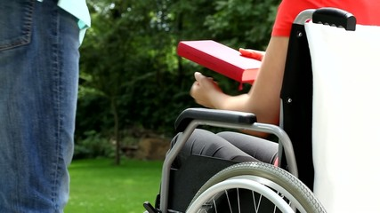 Young woman on wheelchair in garden video