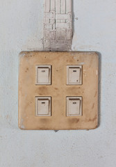 Old switch on cement wall