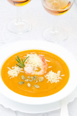 pumpkin soup with shrimp, Parmesan and rosemary and two glasses