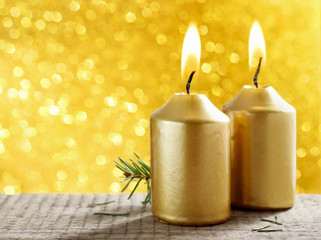 Golden candles. Gold glittering christmas lights. Blurred abstra
