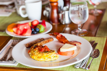 Breakfast with omelet, fresh fruits and coffee