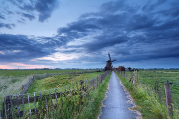 Dutch farmland with windmill in morning