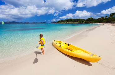 Little girl with kayak