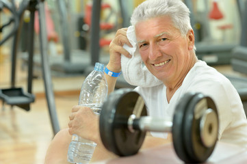 Elderly man in a gym.