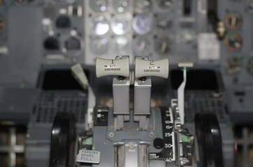 View of aircraft thrust lever in pilot's cabin.