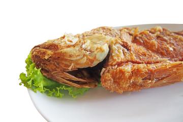 close up head of fried nile tilapia fish