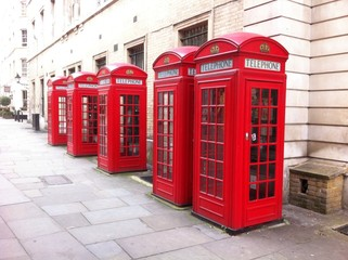 5 red phone boxes in London UK