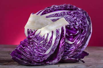 Red cabbage on a wooden table with light background