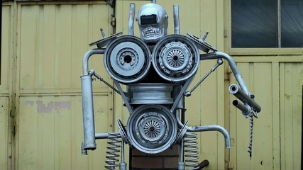 Robot sculpture from old car parts near the Car Service.
