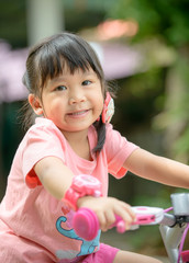 cute Asian girl ride bicycle