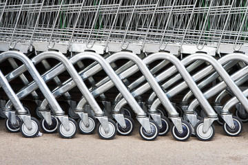 Wheel of Shopping carts on a parking lot . Detail of a shopping