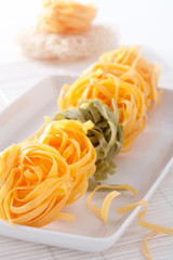 Dry pasta on white plate