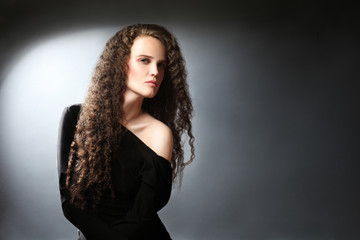 Elegant curly woman portrait.