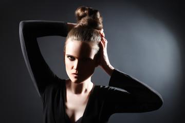 Fashion woman studio portrait with updo