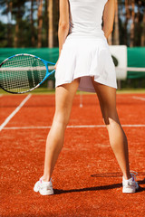 Feeling confident on tennis court.
