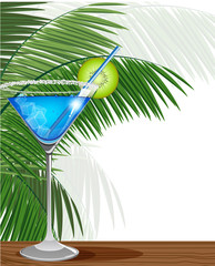 Blue cocktail with kiwi and palm branches