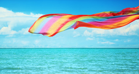Colorful tissue flying over the sea
