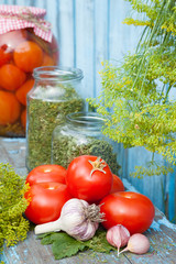 Homemade canned tomatoes in glass jar. Fresh vegetables and spic