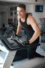 athlete exercising on a stationary bike
