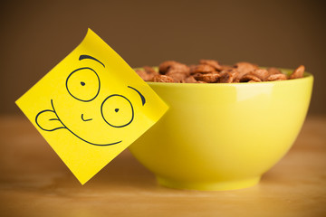 Post-it note with smiley face sticked on a bowl