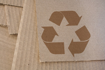 Cardboard with recycle symbol