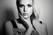 black and white portrait of beautiful blond woman.girl in dress