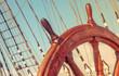 Leinwandbild Motiv Steering wheel of old sailing vessel