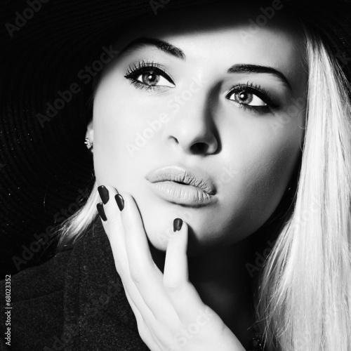 Beautiful Woman in Hat.Elegance Beauty Girl.Monochrome portrait