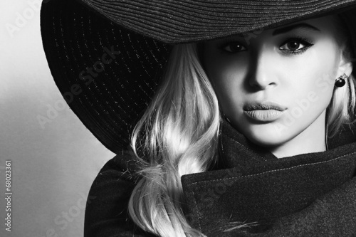 Monochrome portrait of Beautiful Blond Woman in Black Hat