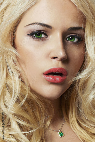 portrait of young woman.beautiful blond girl with green eyes
