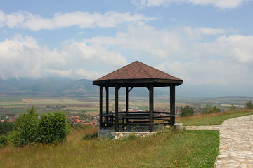 Wooden pavilion high above a small village
